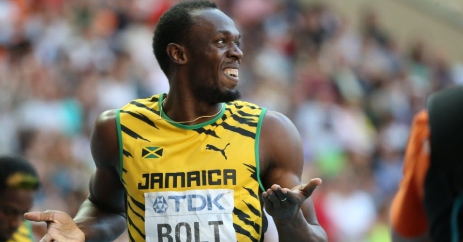 16.ago.2013 - Usain Bolt sorri ao vencer sua bateria semifinal dos 200 m no Mundial de Moscou