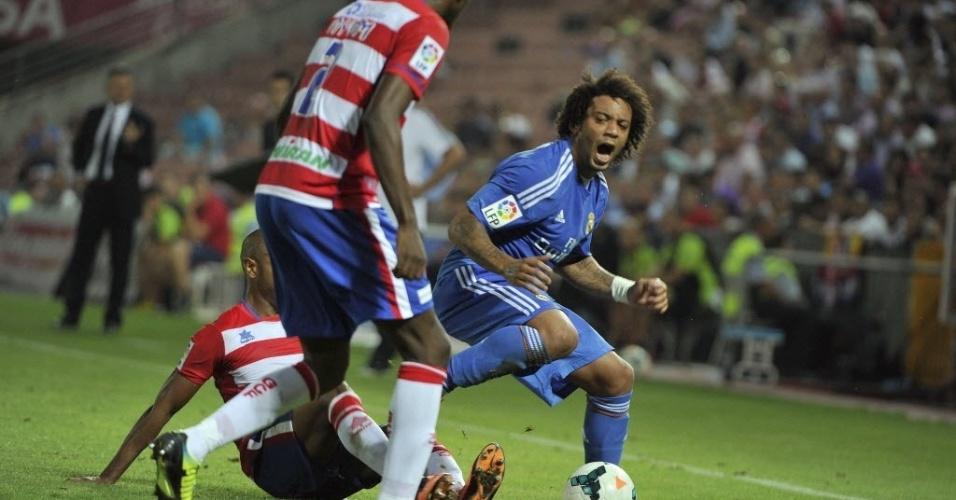 26.ago.2013 - Lateral esquerdo Marcelo tenta a jogada na partida entre Real Madrid e Granada