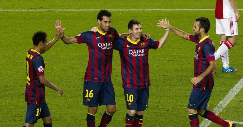 18.set.2013 - Neymar, Busquets, Messi e Fabregas comemoram gol do Barcelona na goleada por 4 a 0 sobre o Ajax