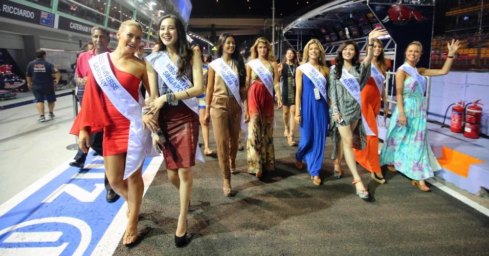 As belas representantes de países do mundo todo passeiam pelo GP de Cingapura