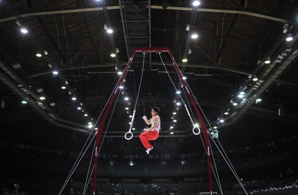 30.09.2013 - Pablo Braegger, da Suíça, encerra sua série nas argolas durante o Individual Geral no Mundial