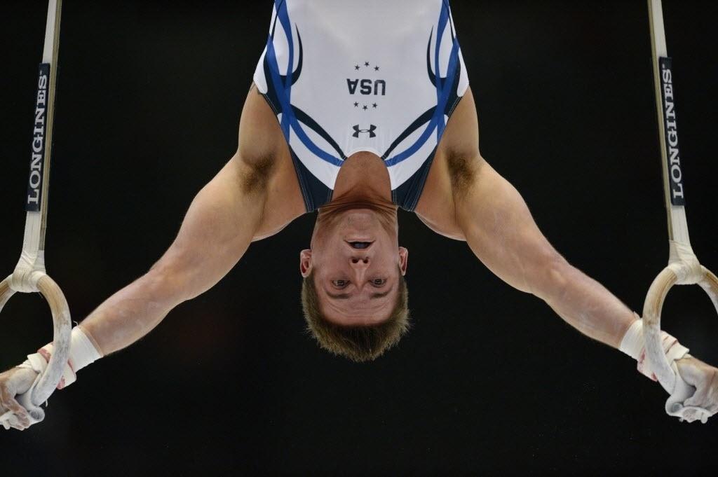 30.09.2013 - Samuel Mikulak faz sua série nas argolas durante as eliminatórias do individual geral, no Mundial de Ginástica