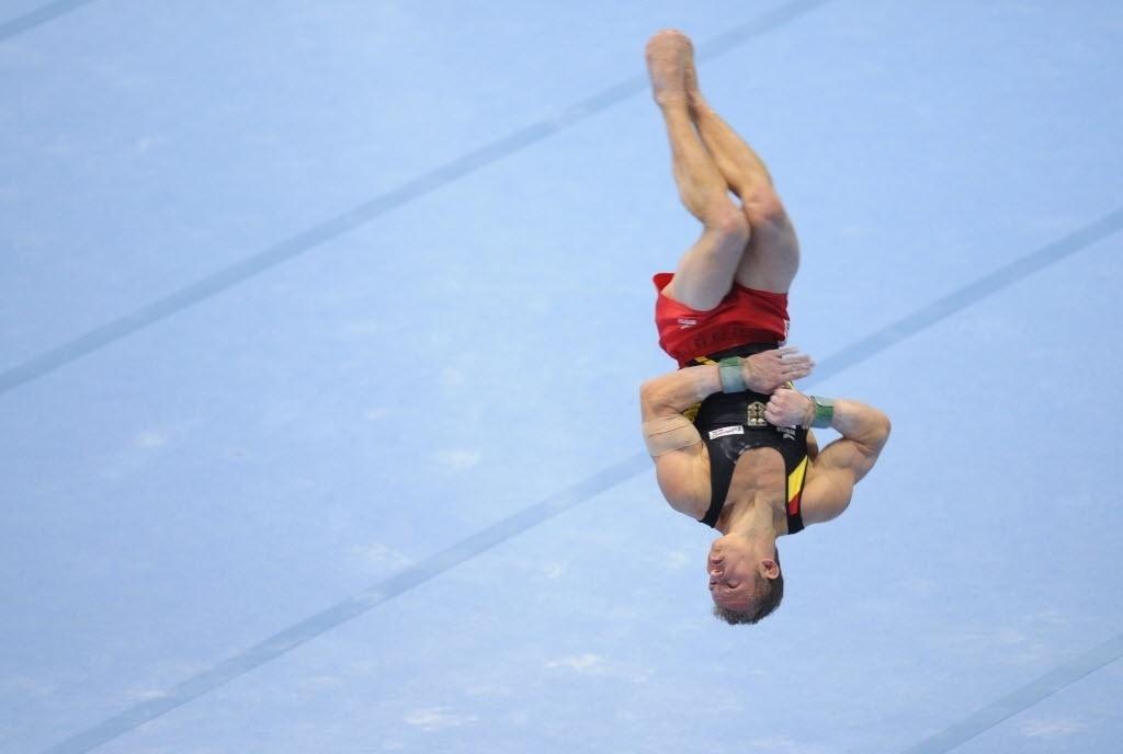 30.set.2013 - Fabian Hambuechen, da Alemanha, salta durante a sua apresentação de solo no Mundial de Ginástica na Antuérpia (BEL)