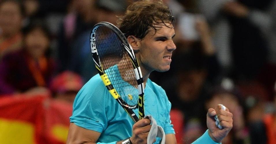 01.out.2013 - Rafael Nadal vibra após derrotar Santiago Giraldo na estreia em Pequim