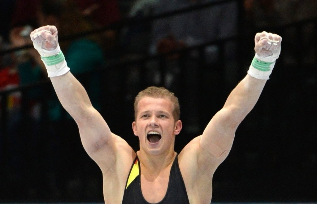 03.10.2013 - Fabian Hambuechen, da Alemanha, comemora a medalha de bronze no Individual Geral no Mundial da Antuérpia