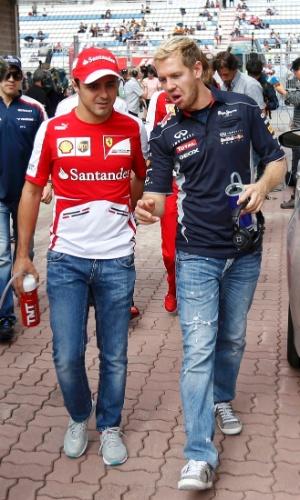 Felipe Massa caminha pelo paddock ao lado de Sebastian Vettel, antes da largada do GP da Coreia do Sul