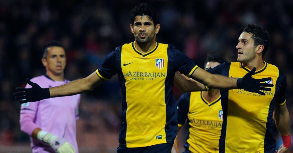 31.out.2013 - Diego Costa comemora após abrir o placar para o Atlético de Madri contra o Granada pelo Campeonato Espanhol
