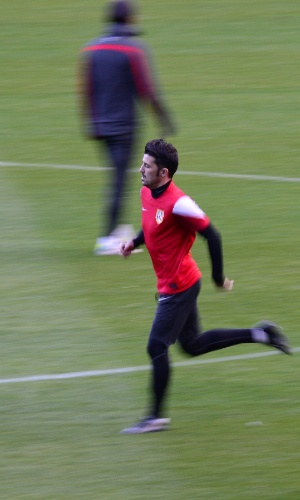 05.nov.2013 - David Villa corre pelo gramado durante treino do Atlético de Madrid