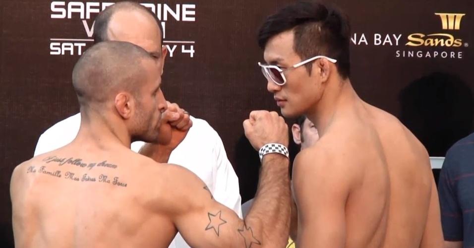 Protagonistas do primeiro UFC em Cingapura - neste sábado às 9h30 - Tarec Saffiedine e Hyun Gyu Lim se encaram na pesagem