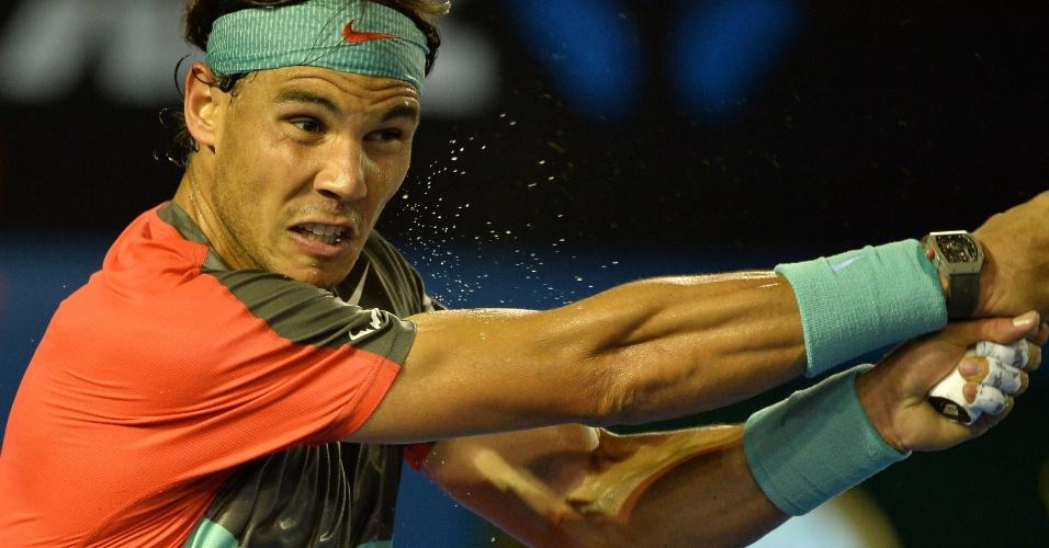 18.01.2014 - Rafael Nadal troca bolas com Gael Monfils