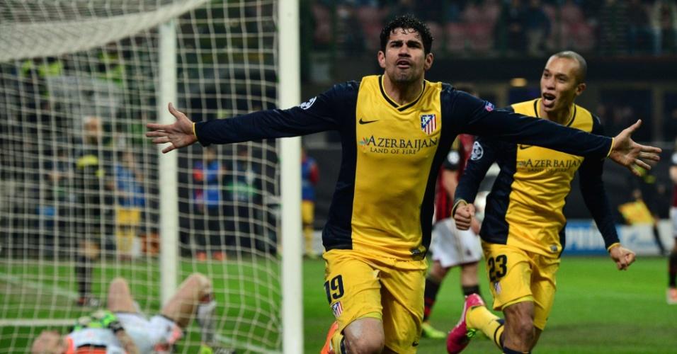 19.fev.2014 - Atacante Diego Costa vibra com gol da vitória do Atlético de Madri sobre o Milan ao lado do zagueiro Miranda, pela Liga dos Campeões