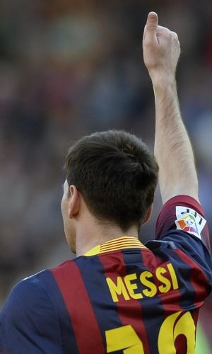 16.mar.2014 - Messi comemora gol pelo Barça. O jogador argentino balançou as redes pela equipe catalã 371 vezes e se isola como maior artilheiro da história do time