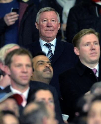 19.mar.2014 - Ex-treinador do Manchester United, Alex Ferguson vai ao estádio de Old Trafford assistir ao jogo entre o time inglês e o Olympiakos, da Grécia, pelas oitavas da Liga dos Campeões