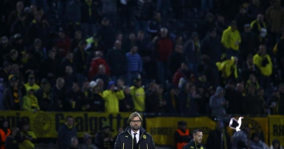 08.abr.2014 - Técnico do Borussia, Juergen Klopp aguarda o início do segundo duelo contra o Real Madrid pelas quartas da Liga. Jogando em casa, o time de Dortmund terá de reverter uma vantagem de 3 a 0 imposta pelos espanhois no jogo de ida.