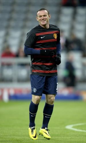 9.abr.2014 - Atacante do Manchester United, Wayne Rooney, faz aquecimento antes do confronto com o Bayern de Munique, pela Liga dos Campeões