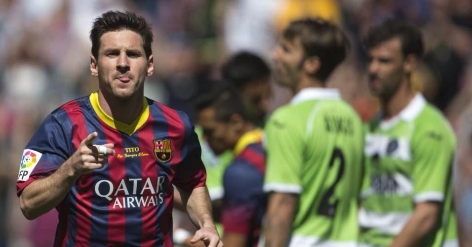 03.mai.2014 - Messi comemora após marcar para o Barcelona na partida contra o Getafe pelo Campeonato Espanhol