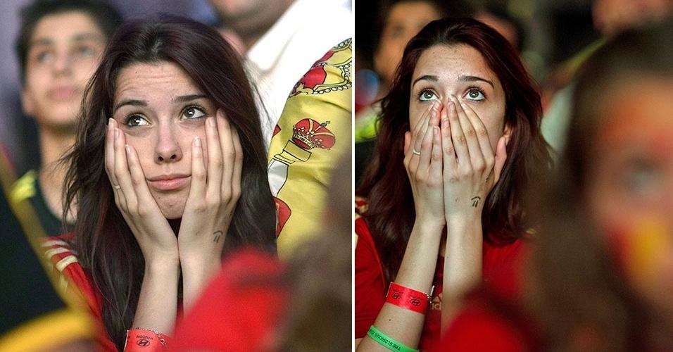 13.jun.2014 - Torcedora espanhola sofre com a goleada aplicada pela Holanda na estreia das seleções na Copa