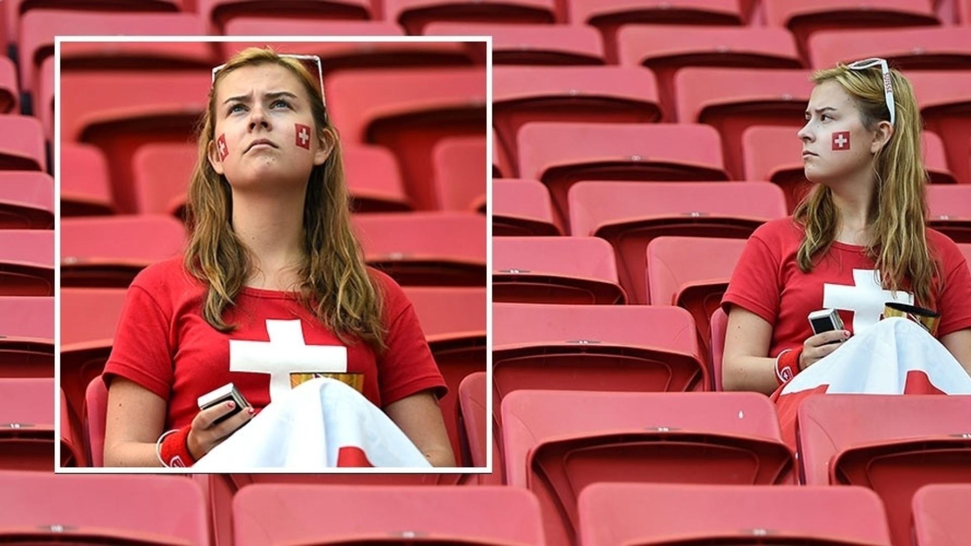 15.jun.2014 - Solitária na arquibancada, torcedora da Suíça aguarda o confronto com o Equador a caráter para a Copa