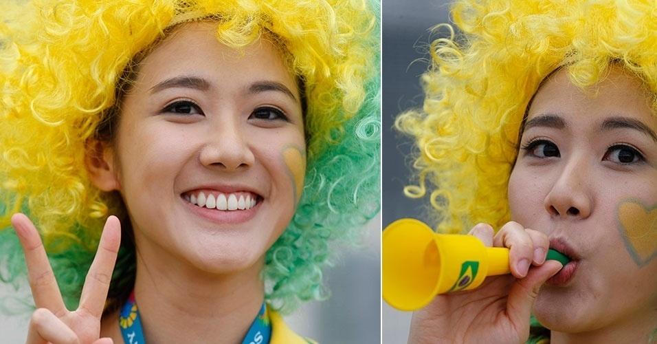 17.jun.2014 - Torcedora com traços orientais apoia o Brasil pouco antes do jogo contra o México, em Fortaleza