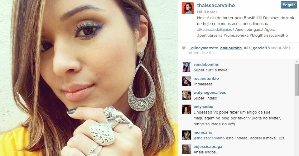 Atriz Thaissa Carvalho, que é a namorada de Dani Alves, mostra seu look com as cores do Brasil para ver a seleção