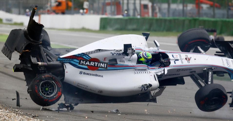 Carro de Felipe Massa capota após choque com Magnussen na primeira curva do GP da Alemanha, vencido por Rosberg