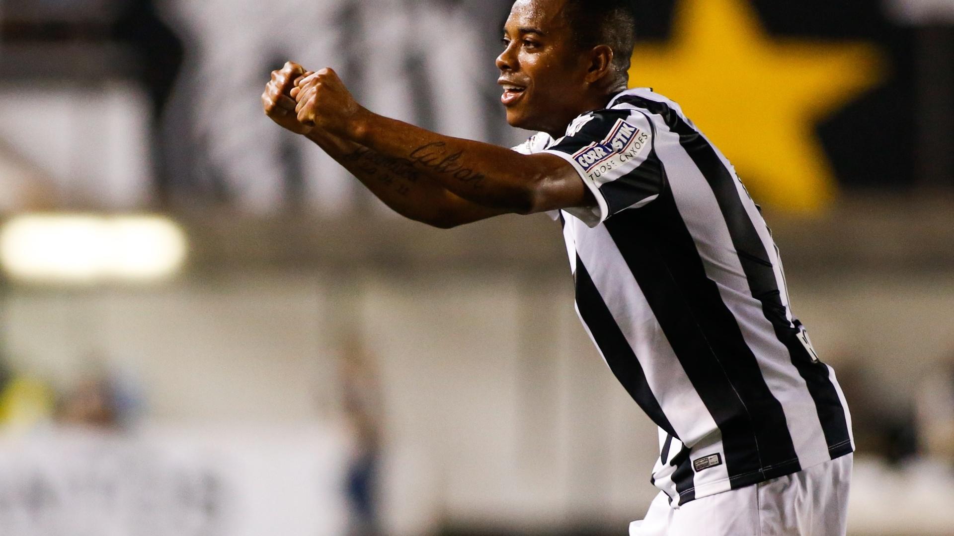 Robinho acena para os torcedores após comemorar o golaço na Vila