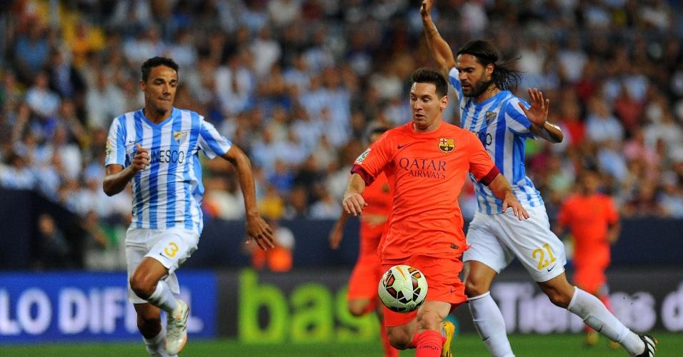 Weligton (esquerda) marcar Messi durante o jogo entre Barcelona x Málaga