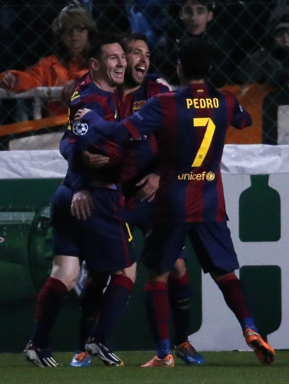 Messi (esquerda) comemora gol do Barcelona na Liga dos Campeões