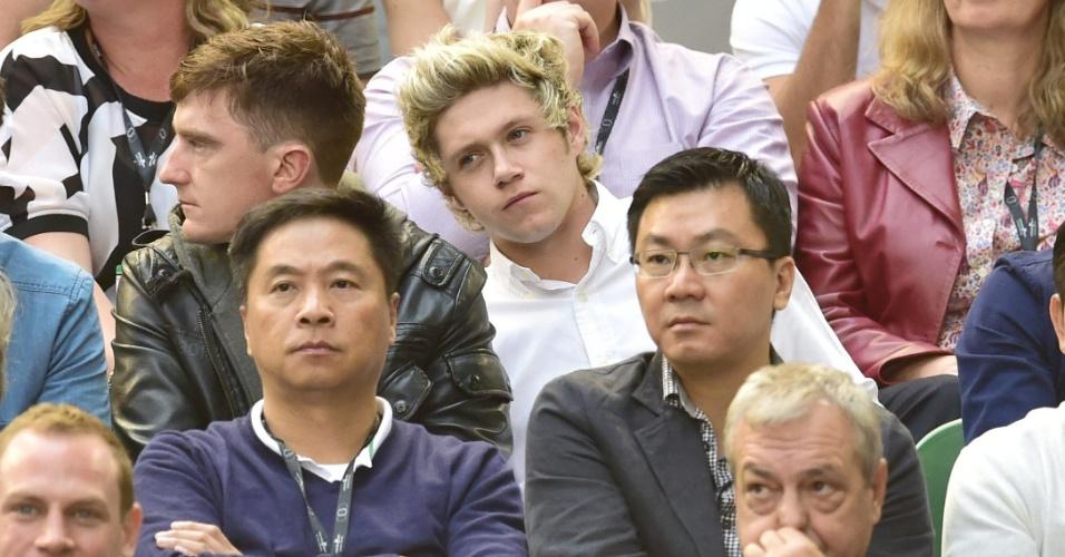 Cantor britânico Niall (centrpo), do grupo One Direction, em Melbourne acompanhando a final