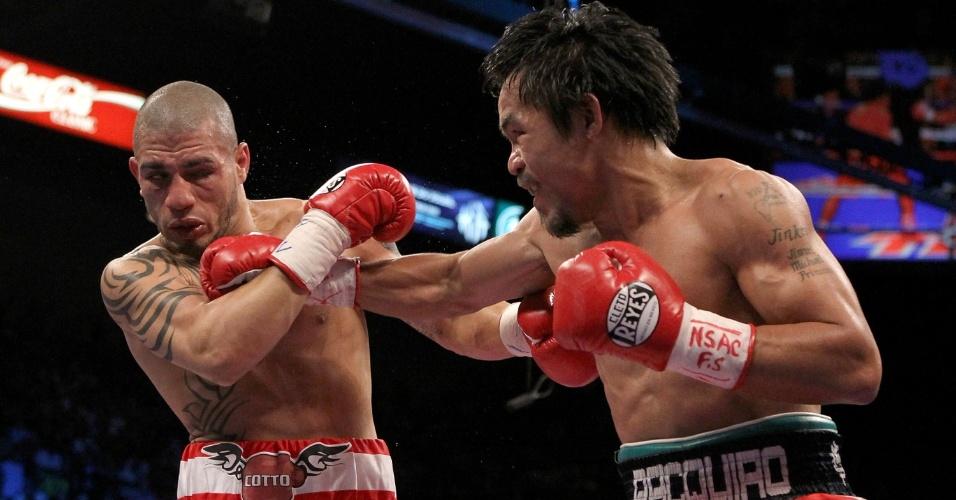 14 de novembro de 2009 - Vitória por nocaute técnico no 12 assalto sobre Miguel Cotto. Muitos achavam que o porto-riquenho fosse desbancar o filipino com sua força, mas Pacquiao mostrou que também é muito técnico