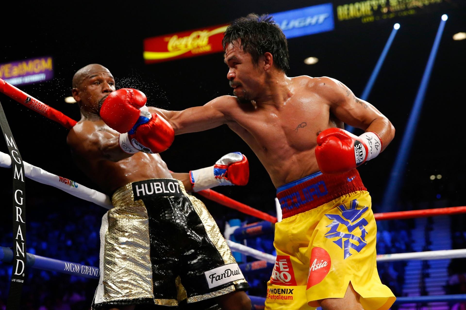 Mayweather consegue se esquivar de mais um golpe de Manny Pacquiao