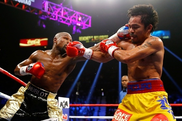 Mayweather e Pacquiao trocam golpes durante duelo na MGM Arena