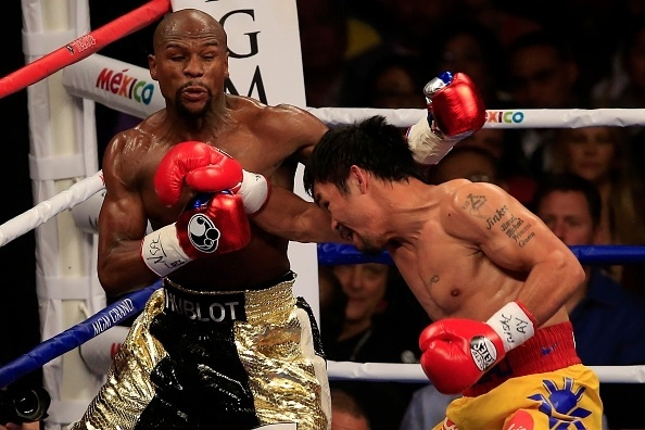 Mayweather e Pacquiao trocam golpes durante luta na MGM Arena