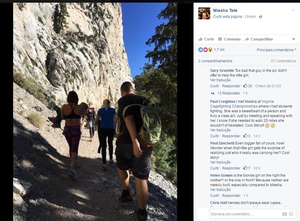 Miesha Tate carrega garotinha que quebrou o braço durante uma trilha