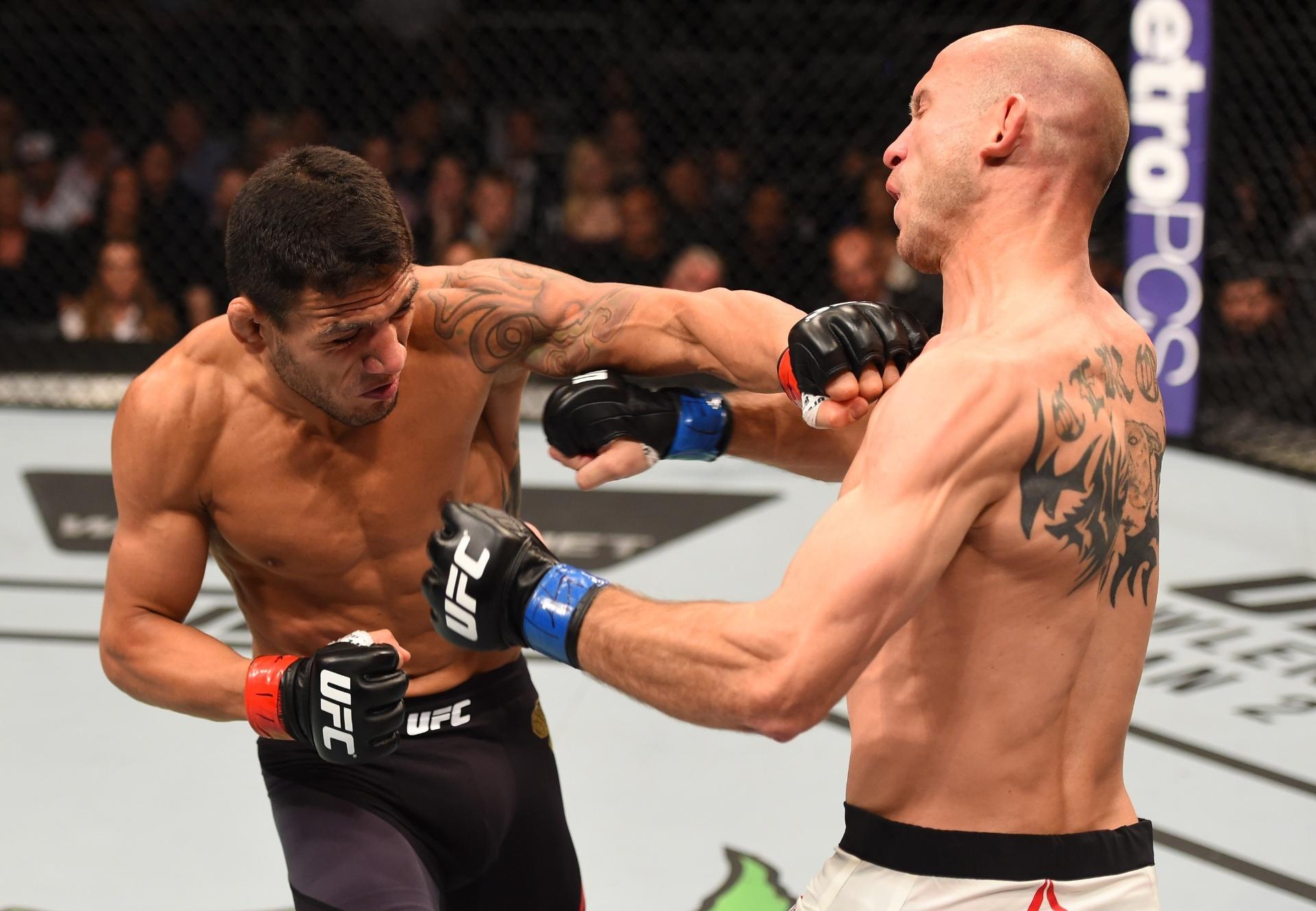 Rafael dos Anjos acerta soco em Cerrone, no UFC Fight Night Orlando
