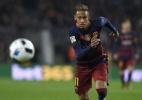 CEO defende Neymar e afirma que Santos ainda deve ao atacante - AFP PHOTO / LLUIS GENE