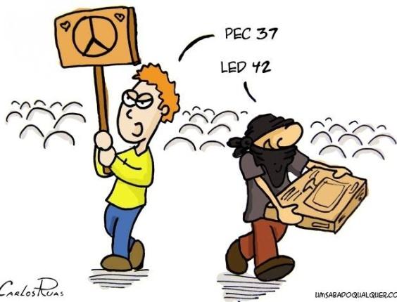 24.jun.2013 - O cartunista Carlos Ruas faz uma sátira aos atos de vandalismo que ocorrem durante as manifestações