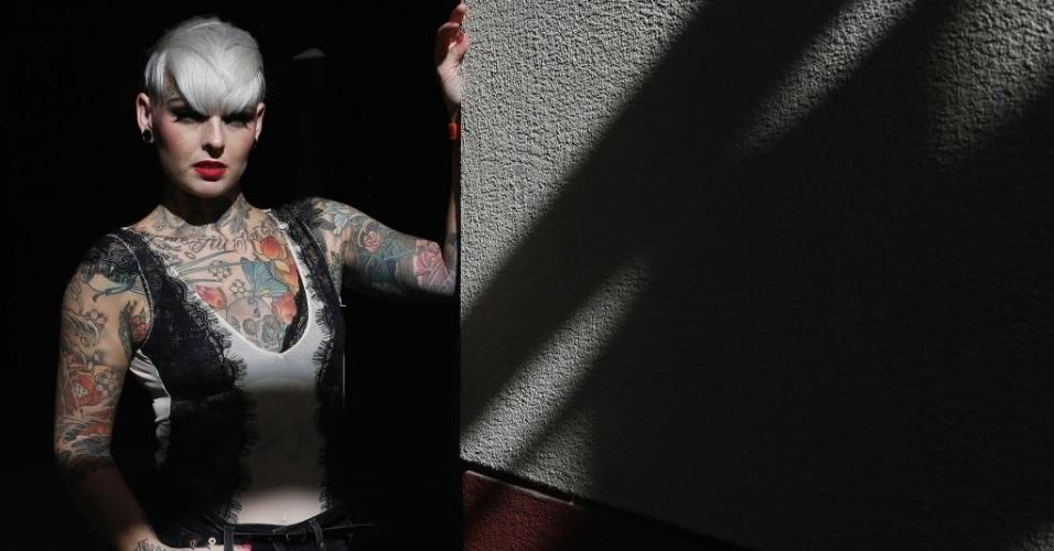 28.set.2013 - Jade Allison mostra suas tatuagens durante 9ª Convenção Internacional de Tatuagem em Londres. O evento reúne cerca de 300 artistas