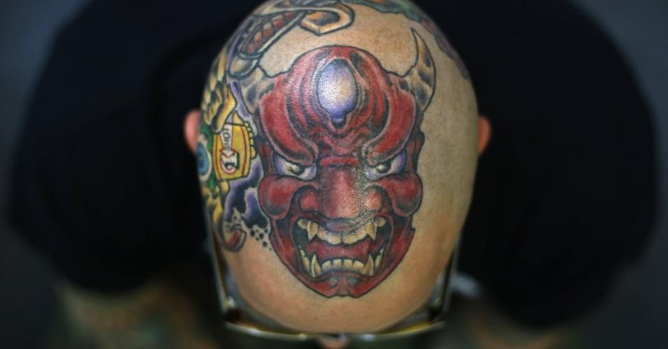 28.set.2013 - Matt Grosso mostra tatuagem em sua cabeça durante 9ª Convenção Internacional de Tatuagem em Londres. O evento reúne cerca de 300 artistas