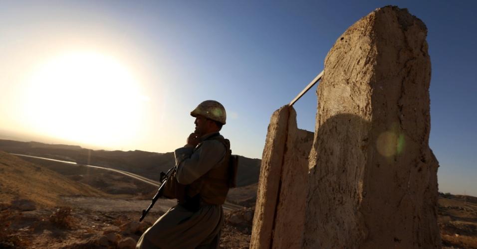 09.ago.2014 - Membro das forças curdas (