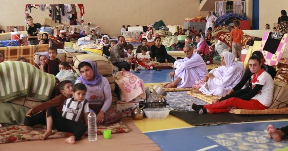 29.ago.2014 - Refugiados da minoria yazidi da cidade de Sinjar, estão abriados em escola, na província de Dohuk, no Iraque