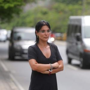 A funcionária do Detran-RJ Luciana Tamburini disse que vai doar o valor excedente a uma instituição de caridade