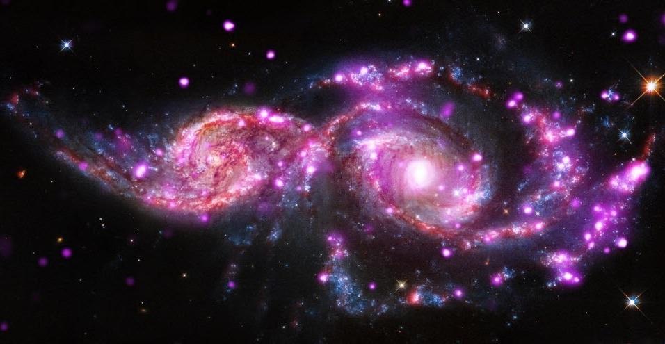 Moon hoax...  - Página 2 12dez2014---galaxias-coloridas---imagem-divulgada-pela-nasa-feita-pelo-telescopio-espacial-hubble-mostra-o-par-de-galaxias-ngc-2207-e-ic-2163-localizadas-a-cerca-de-130-milhoes-de-anos-luz-da-terra-1418404623549_956x495