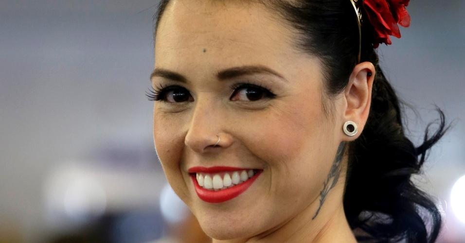 18.jan.2015 - A paulistana Silvia Santos, 30 anos, cabeleireira de Itu (SP), venceu o concurso Miss Tattoo 2015, realizado na Tattoo Week, no Centro de Convenções Sulamérica, no centro do Rio de Janeiro (RJ). O evento é a maior feira brasileira de tatuagens.
