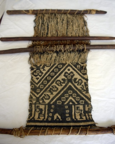12.mar.2015 - Tapeçaria pré-incaica em exposição no museu Puruchuco, em Lima, no Peru. No sítio arqueológico, já foram descobertas mais de 2.000 múmias, além de cerâmicas e centenas de tecidos e artefatos de ouro, prata e cobre