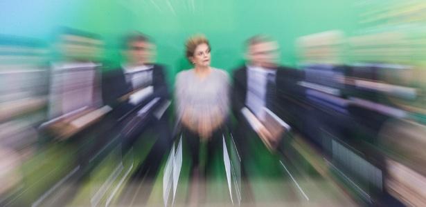 A presidente Dilma Roussef (centro) durante evento com juristas no Planalto