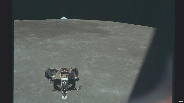 A Terra aparece atrás do horizonte da Lua