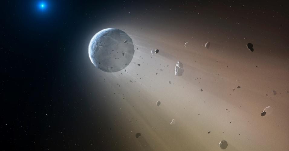 21.out.2015 - Astrônomos detectaram, pela primeira vez, um minúsculo objeto rochoso se desintegrando próximo a uma estrela anã branca. Nesta concepção artística, é possível ter uma ideia do que os cientistas da missão K2 da 21.out.2015 - Nasa enxergaram: ao se desintegrar, o objeto se vaporiza e deixa uma poeira metálica na superfície da estrela. Esta descoberta confirma uma teoria existente há muitos anos, mas antes nunca comprovada, que as anãs brancas são capazes de ?canibalizar? possíveis planetas. ?Nós observamos uma espécie de planeta em miniatura se desintegrando por causa da intensa gravidade?, afirmou um dos autores do estudo que confirmou a teoria, publicado na revista Nature, Andrew Vanderburg