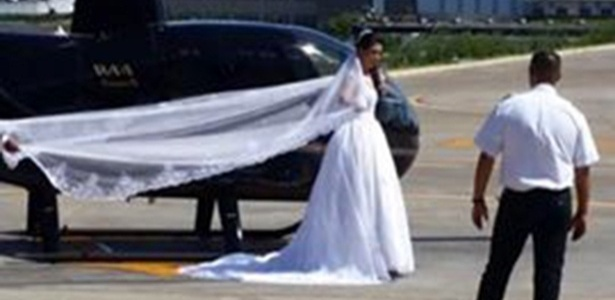 4.dez.2016 - Vestida de noiva, Rosemeire Nascimento Silva aparece em foto publicada no Snapchat do piloto do helicóptero, Peterson Pinheiro